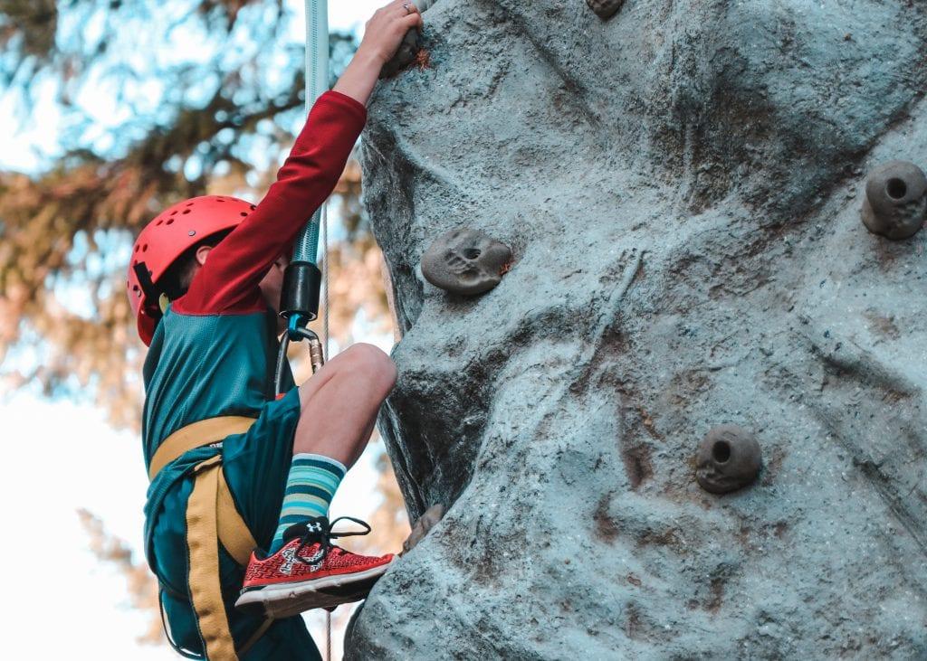 person-climbing-on-gray-rock-3058762