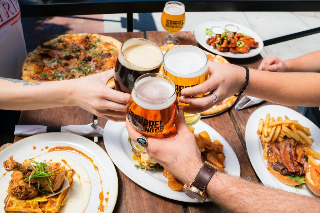 A group enjoying tasty food paired with freshly brewed craft beers.