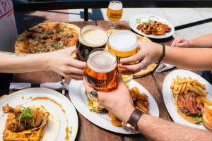A group enjoying tasty food paired with freshly brewed craft beers-Ottawa breweries