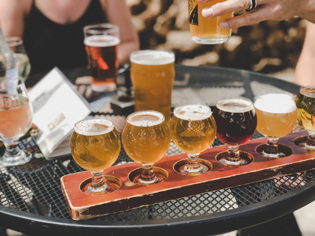 Enjoy craft beer tasting while the bus tours