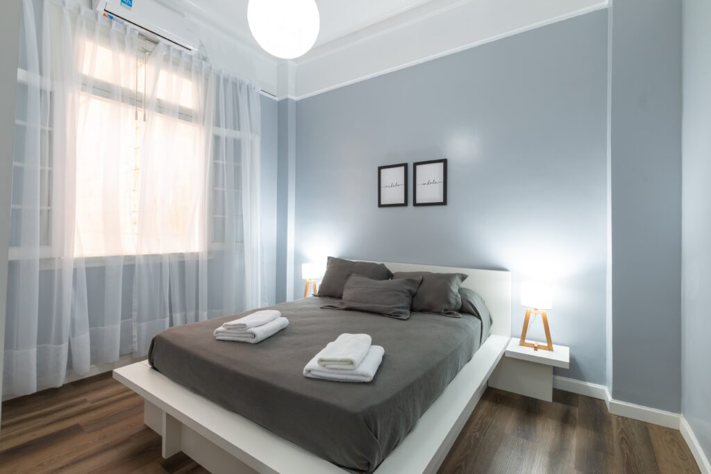 A sophisticated bedroom with grey linen bedsheet