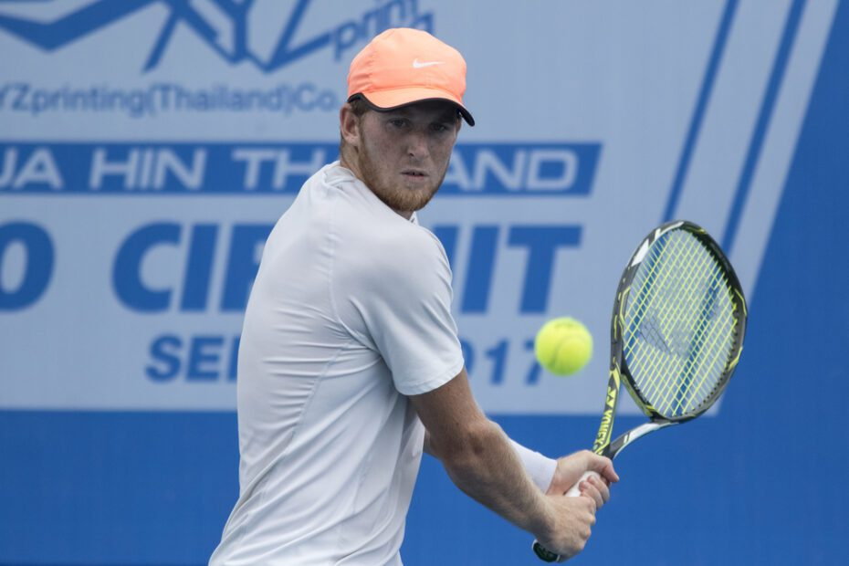 Harry Bourchier of Australia returns a ball during Day 3 of ITF Thailand Men's Pro Circuit on June 7, 2017
